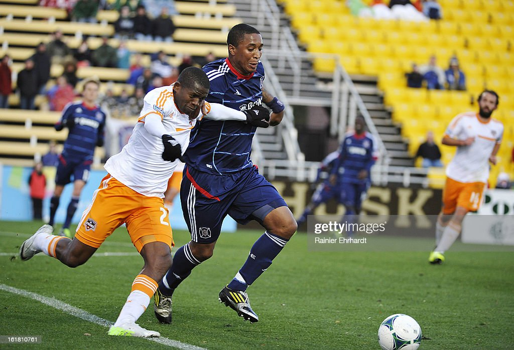 Sherjill MacDonald #7 of the Chicago Fire and Boniek Garcia #27 of the Houston Dynamo fight for the ball during the first half of their game in the Carolina Challenge Cup at Blackbaud Stadium on February 16, 2013 in Charleston, South Carolina.