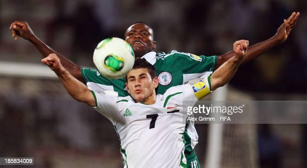 Sherko Kareem of Iraq is challenged by Aliyu Abubakar of Nigeria during the FIFA U17 World Cup UAE 2013 Group F match between Nigeria and Iraq at Al...