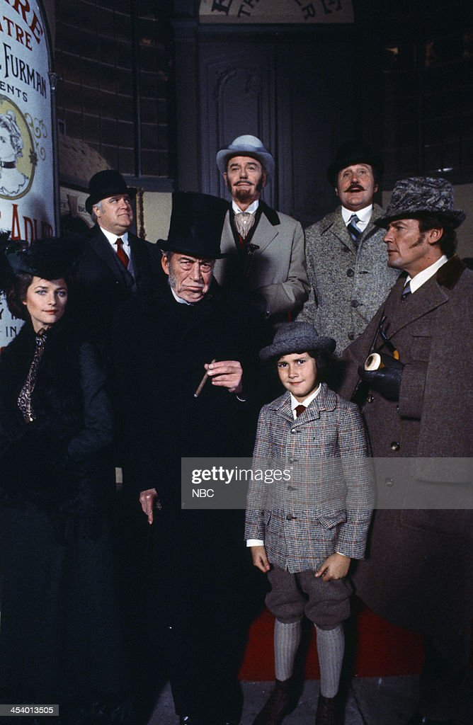 MOVIES -- 'Sherlock Holmes in New York' -- Pictured: (l-r) Charlotte Rampling as Irene Adler, David Huddleston as Inspector Lafferty, John Huston as Professor Moriarty, Gig Young as Mortimer McGraw, Geoffrey Moore as Scott Adler, Patrick Macnee as Doctor Watson, Roger Moore as Sherlock Holmes --