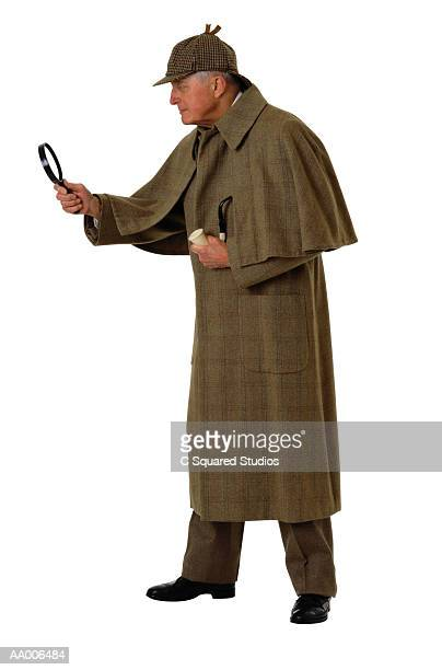 sherlock holmes looking into a magnifying glass - sherlock holmes stock pictures, royalty-free photos & images