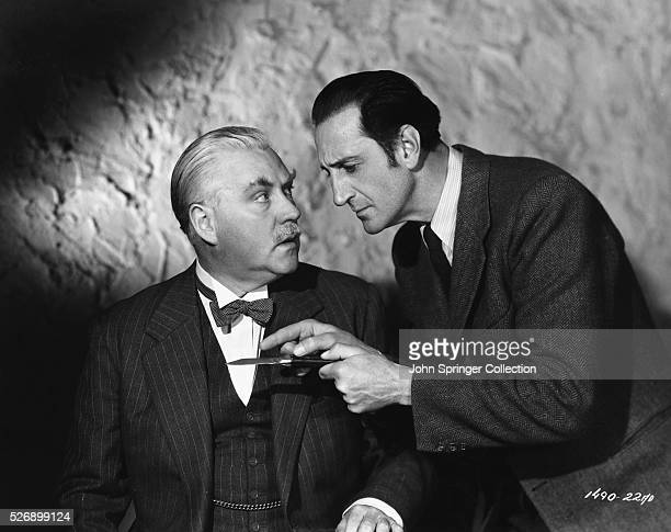 Sherlock Holmes show Dr. Watson a knife in the 1946 film Dressed to Kill.