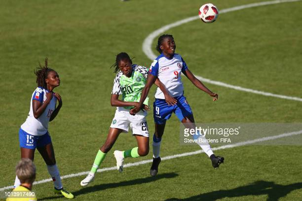 Sherly Jeudy of Haiti wins a header from Aishat Bello of Nigeria during the FIFA U20 Women's World Cup France 2018 group D match between Haiti and...