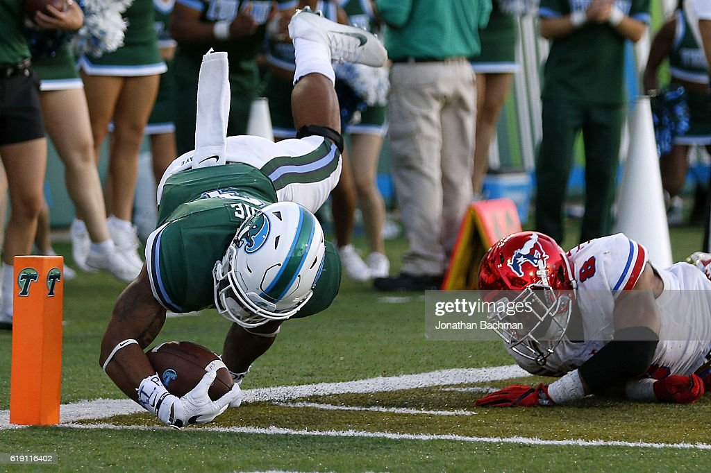 Sherman Badie #3 of the Tulane Green Wave scores a touchdown past Rodney Clemons #8 of the Southern Methodist Mustangs during the second half of a game at Yulman Stadium on October 29, 2016 in New Orleans, Louisiana.