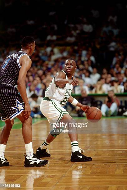 Sherman Douglas of the Boston Celtics handles the ball against Anfernee Hardaway of the Orlando Magic during a game played circa 1994 at the Boston...