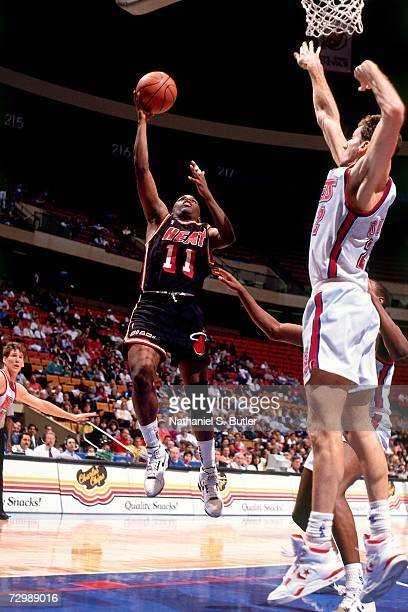 Sherman Douglas of the Miami Heat attempts a layup against the New Jersey Nets during a 1991 NBA game at Brendan Byrne Arena in East Rutherford New...