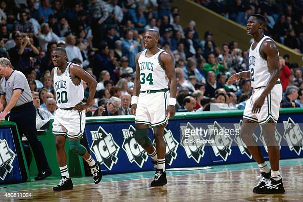 Sherman Douglas Xavier McDaniel and Dominique Wilkins of the Boston Celtics stand on the court during a game played in 1995 against the Orlando Magic...