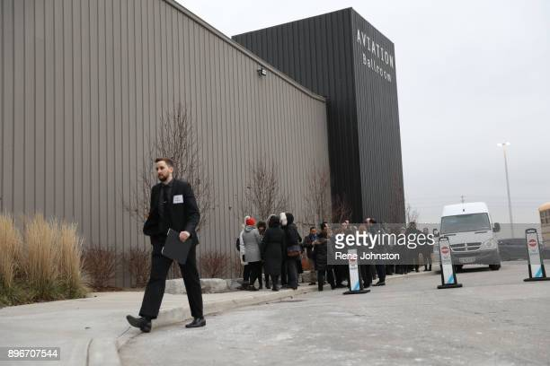 TORONTO ON DECEMBER 21 Sherman Funeral Public line up arrive the to pay their respects to Honey and Barry Sherman at International Center
