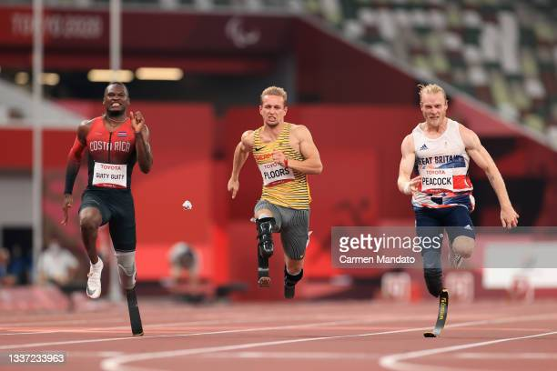 Sherman Isidro Guity Guity of Team Costa Rica, Johannes Floors of Team Germany and Jonnie Peacock of Team Great Britain compete in the men's 100m -...