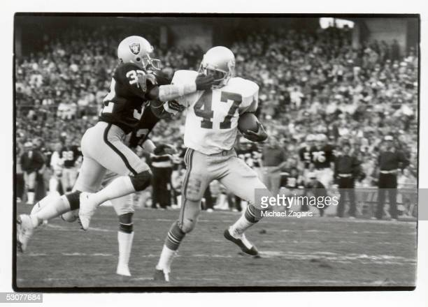 Sherman Smith of the Seattle Seahawks fights off Jack Tatum of the Oakland Raiders during the game at the Oakland Alameda Coliseum on November 6 1977...
