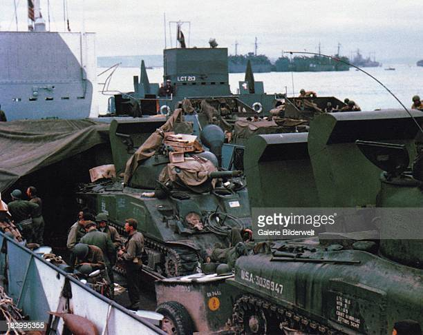 Sherman tanks and troops have been loaded into a Landing Craft Tank in Southern England 5th June 1944 This ship will participate in the invasion of...