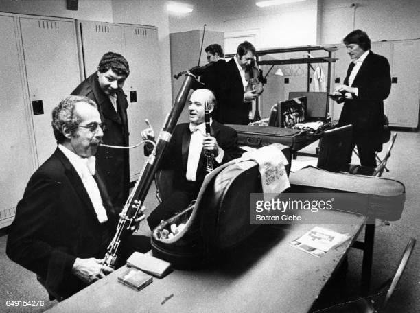 Sherman Walt principal bassoon Alfred Genovese oboe and Harold Wright principal clarinet sit backstage before opening night at the Boston Symphony...