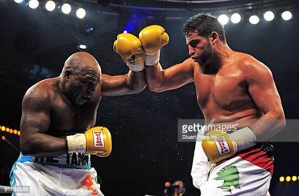 Sherman Williams of the Bahamas and Manuel Charr of the Lebanon exchange ounches during a heavyweight fight during the Universum Champions night...