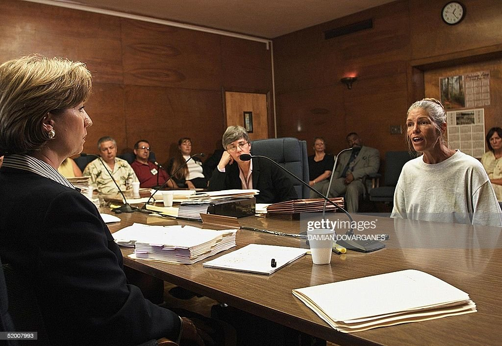 Sheron Lawin (L), a member of the Board of Prison Terms commissioners, listens to Leslie Van Houten (R), after her parole was denied 28 June 2002 at the California Institution for Women in Corona, California. Van Houten, 53, has served over 30 years in prison for her involvement in the Tate-LaBianca killings. Van Houten's attorney Christie Webb is at center.