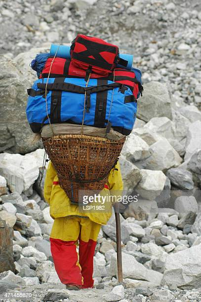 Sherpa carrying equipment to the Everest base camp