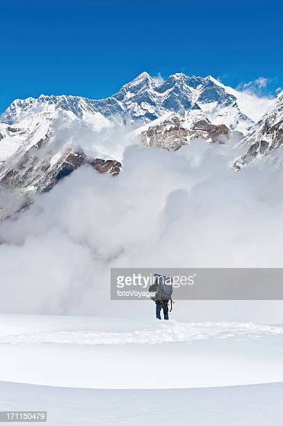 Sherpa mountaineer climbing below Mt Everest mountain summit Himalayas Nepal