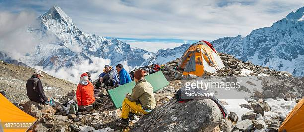 sherpa mountaineers relaxing at base camp annapurna himalayas nepal - annapurna circuit stock photos and pictures
