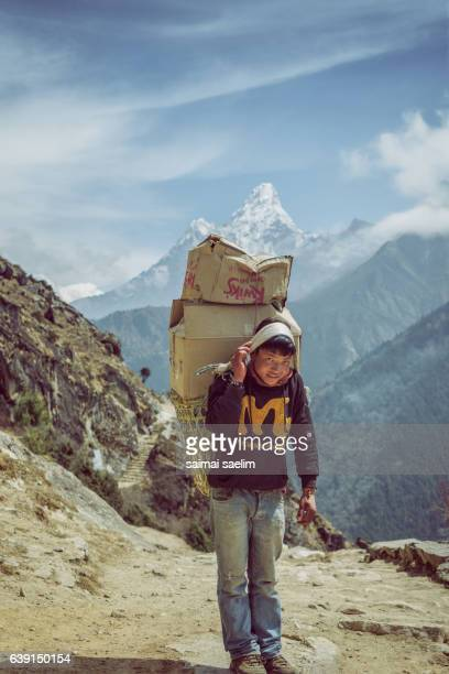 Sherpa Porter with mountain in the background, Nepal