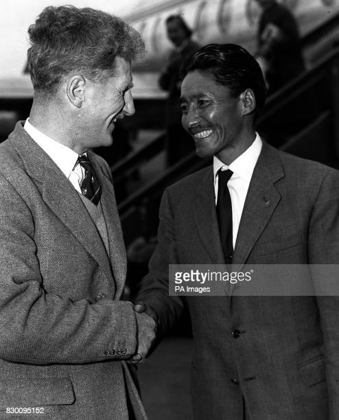 Sherpa Tensing Norgay joint conqueror with Sir Edmund Hillary of the Everest peak is seen being welcomed by Brigadier Sir John Hunt who led the...