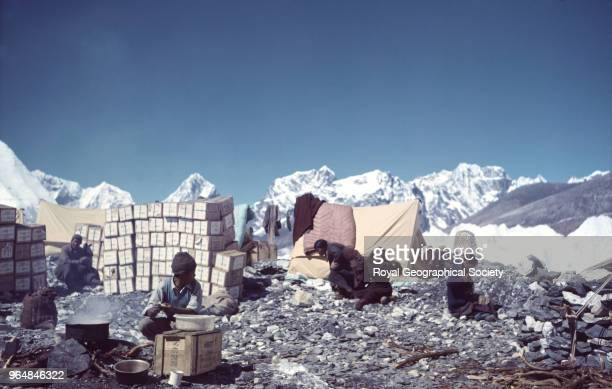Sherpas and Sherpanis with tents boxes and equipment at Base Camp Nepal March 1953 Mount Everest Expedition 1953