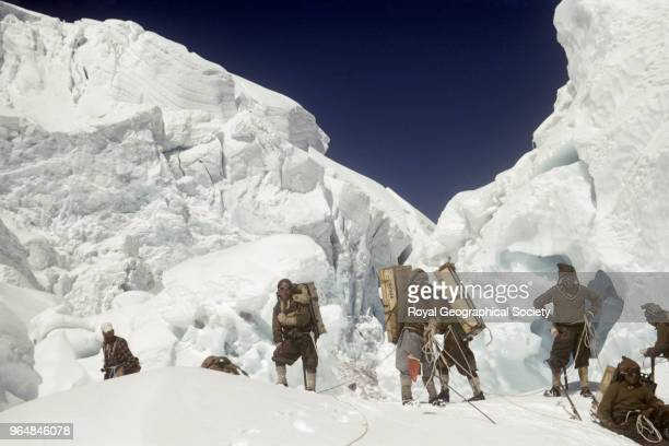 Sherpas with loads in the icefall George Lowe with a group of Sherpas taking a rest in the Khumbu Icefall Not only did the Sherpas have heavy loads...
