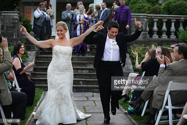 Sherrette Estes L and Maribel Garate pass by their guests immediately after exchanging wedding vows at Glenview Mansion on Saturday June 1 in...