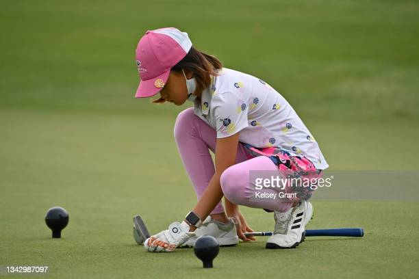 Sherri Xiaochen Lin lines up a putt during the 2021 Drive, Chip and Putt Regional Qualifier at TPC Scottsdale on September 26, 2021 in Scottsdale,...