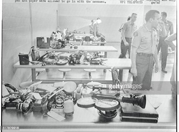 Sherrif's Deputies stand guard over news gathering equipment after it was removed from newsmen before they entered a room in the jail where Sirhan B...