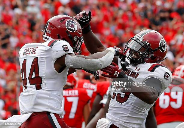 Sherrod Greene and J.T. Ibe of the South Carolina Gamecocks react after a missed field goal by Rodrigo Blankenship of the Georgia Bulldogs in second...