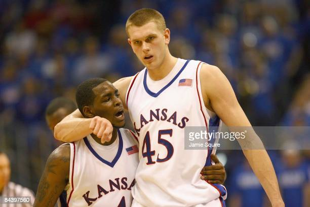 Sherron Collins and Cole Aldrich of the Kansas Jayhawks walk on court against the Tennessee Volunteers on January 3, 2009 at Allen Fieldhouse in...