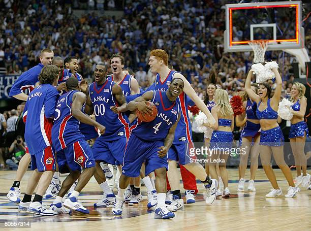 Sherron Collins and the Kansas Jayhawks celebrate after defeating the Memphis Tigers 7568 in overtime during the 2008 NCAA Men's National...