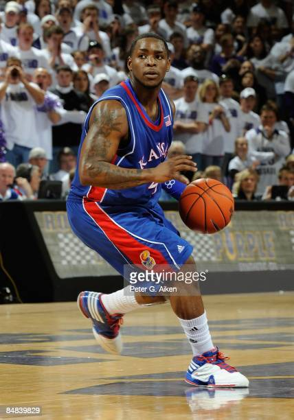 Sherron Collins of the Kansas Jayhawks brings the ball up court against the Kansas State Wildcats on February 14, 2009 at Bramlage Coliseum in...