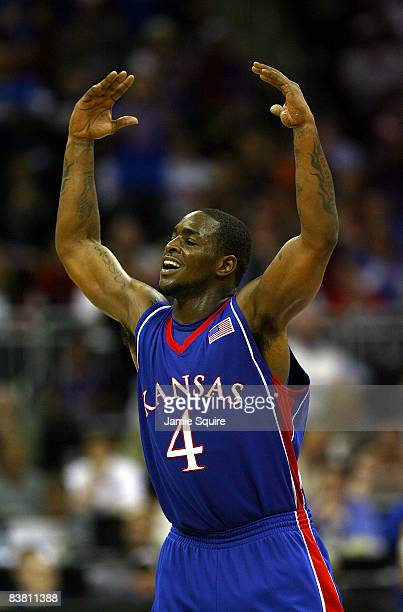 Sherron Collins of the Kansas Jayhawks celebrates after scoring during the CBE Classic game against the Washington Huskies at the Sprint Center in...