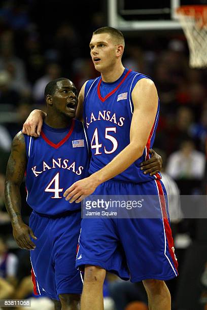 Sherron Collins of the Kansas Jayhawks congratulates Cole Aldrich after Aldrich drew a foul during the CBE Classic game against the Washington...