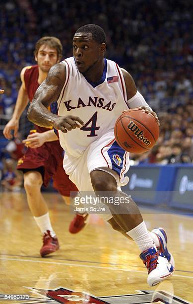 Sherron Collins of the Kansas Jayhawks dribble drives to the basket during the game against the Iowa State Cyclones on February 18, 2009 at Phog...