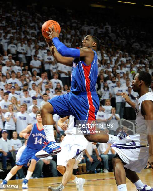 Sherron Collins of the Kansas Jayhawks drives to the basket enroute to a score against the Kansas State Wildcats during the first half on February...