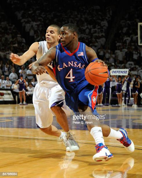 Sherron Collins of the Kansas Jayhawks drives to the basket past Denis Clemente of the Kansas State Wildcats during the first half on February 14,...