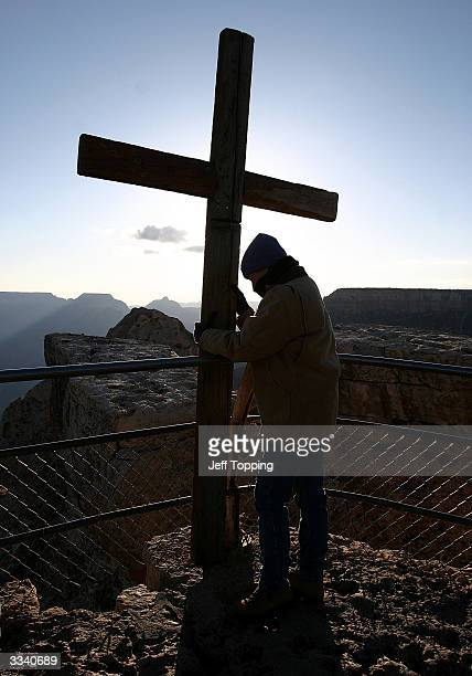 Sherry Baker helps to take down the cross after Easter sunrise service on Mather Point at the south rim of the Grand Canyon in Arizona April 11 2004...
