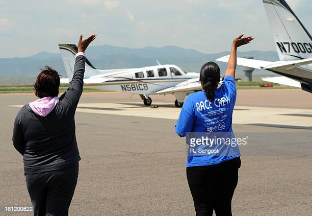 Sherry Delaney left grandmother of Nevin Delaney with sickle cell anemia and Regina Lockhart Nevin's mother wave goodbye to Nevin at Rocky Mountain...