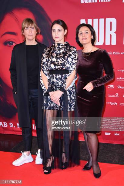 Sherry Hormann, Almila Bagriacik and Sandra Maischberger attend the 'Nur eine Frau' premiere at Kino International movie theater on May 6, 2019 in...