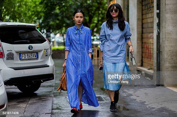 Sherry Shen and Yoyo Lu wearing blue striped dress and top outside Prada during the Milan Men's Fashion Week Spring/Summer 2017 on June 19 2016 in...