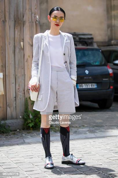 Sherry Shen in Thom Browne total look is seen in the streets of Paris after the Thom Browne show during Paris Men's Fashion Week Spring/Summer 2019...