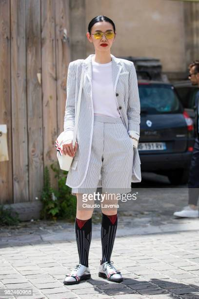 Sherry Shen, in Thom Browne total look, is seen in the streets of Paris after the Thom Browne show, during Paris Men's Fashion Week Spring/Summer...