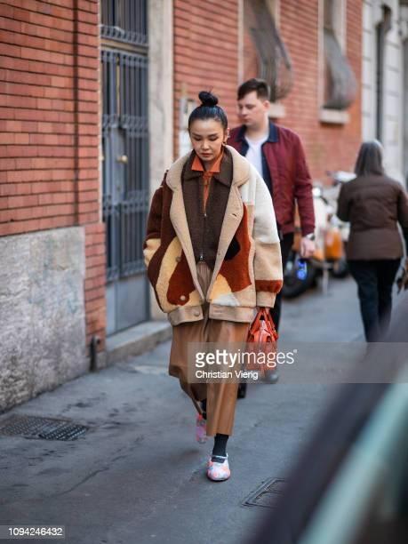 Sherry Shen is seen wearing teddy jacket outside N21 during Milan Menswear Fashion Week Autumn/Winter 2019/20 on January 14 2019 in Milan Italy