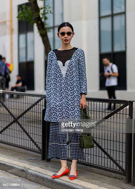 Sherry Shen outside Balenciaga during the Paris Fashion Week Menswear Spring/Summer 2017 on June 22 2016 in Paris France