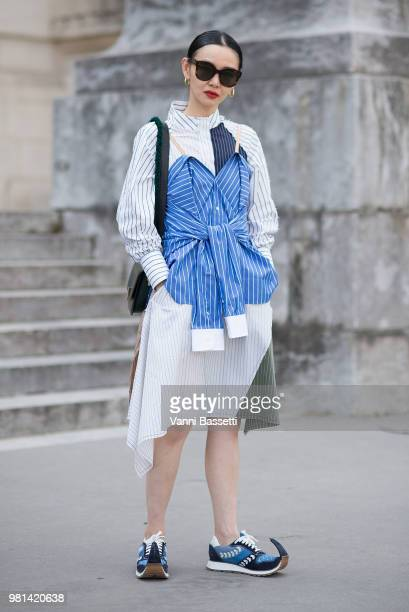 Sherry Shen poses wearing a JW Anderson dress and Loewe shoes after the Cerruti 1881 show at the Grand Palais during Paris Fashion Week Menswear SS19...
