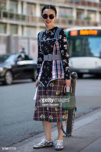 Sherry Shen poses wearing a Miu Miu top and a Marni skirt after the Y Project show during Paris Fashion Week Menswear SS19 on June 20 2018 in Paris...