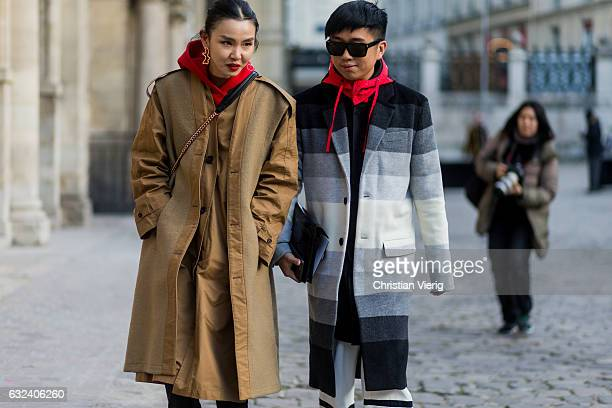 Sherry Shen wearing a beige trench coat and Declan Chan outside Paul Smith on January 22 2017 in Paris France