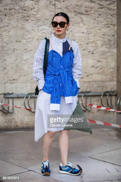 Sherry Shen wearing a JW Anderson dress and Loewe shoes is seen in the streets of Paris before the JuunJ show during Paris Men's Fashion Week...