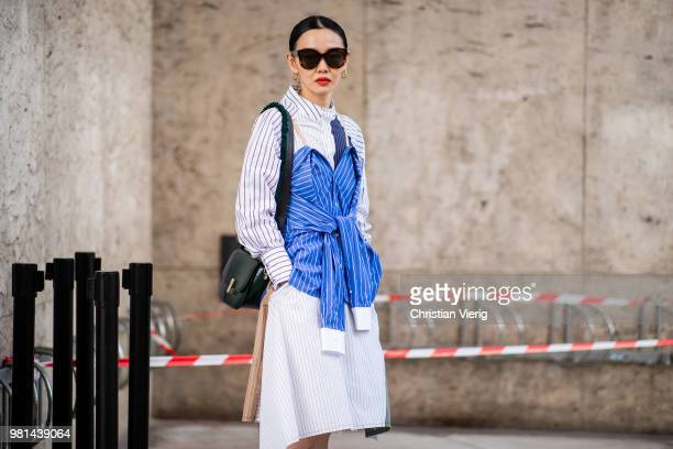 Sherry Shen wearing dress made out of striped button shirts is seen outside Ann Demeulemeester on day four of Paris Fashion Week Menswear SS19 on...