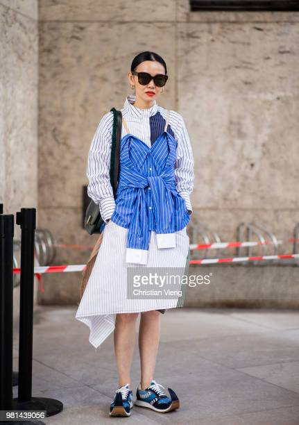 Sherry Shen wearing dress made out of striped button shirts sneakers is seen outside Ann Demeulemeester on day four of Paris Fashion Week Menswear...